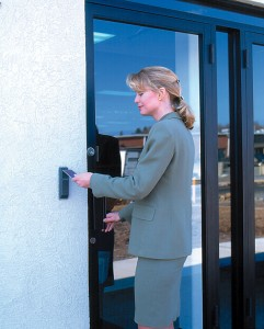 woman using card reader - home security systems